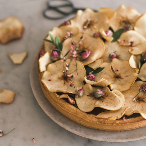 dark chocolate ganache tart with apples and flowers