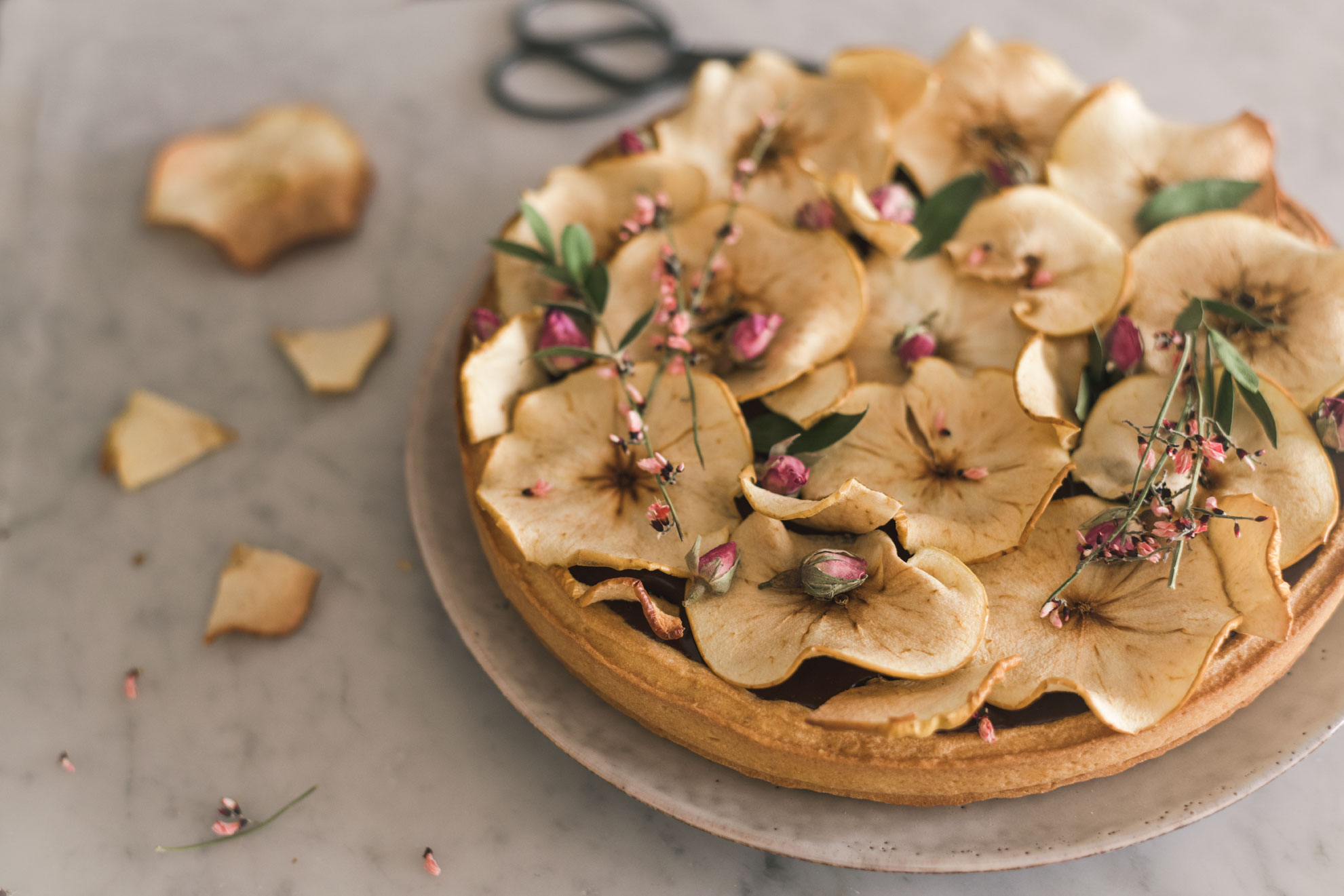 dark chocolate ganache tart with apples and flowers