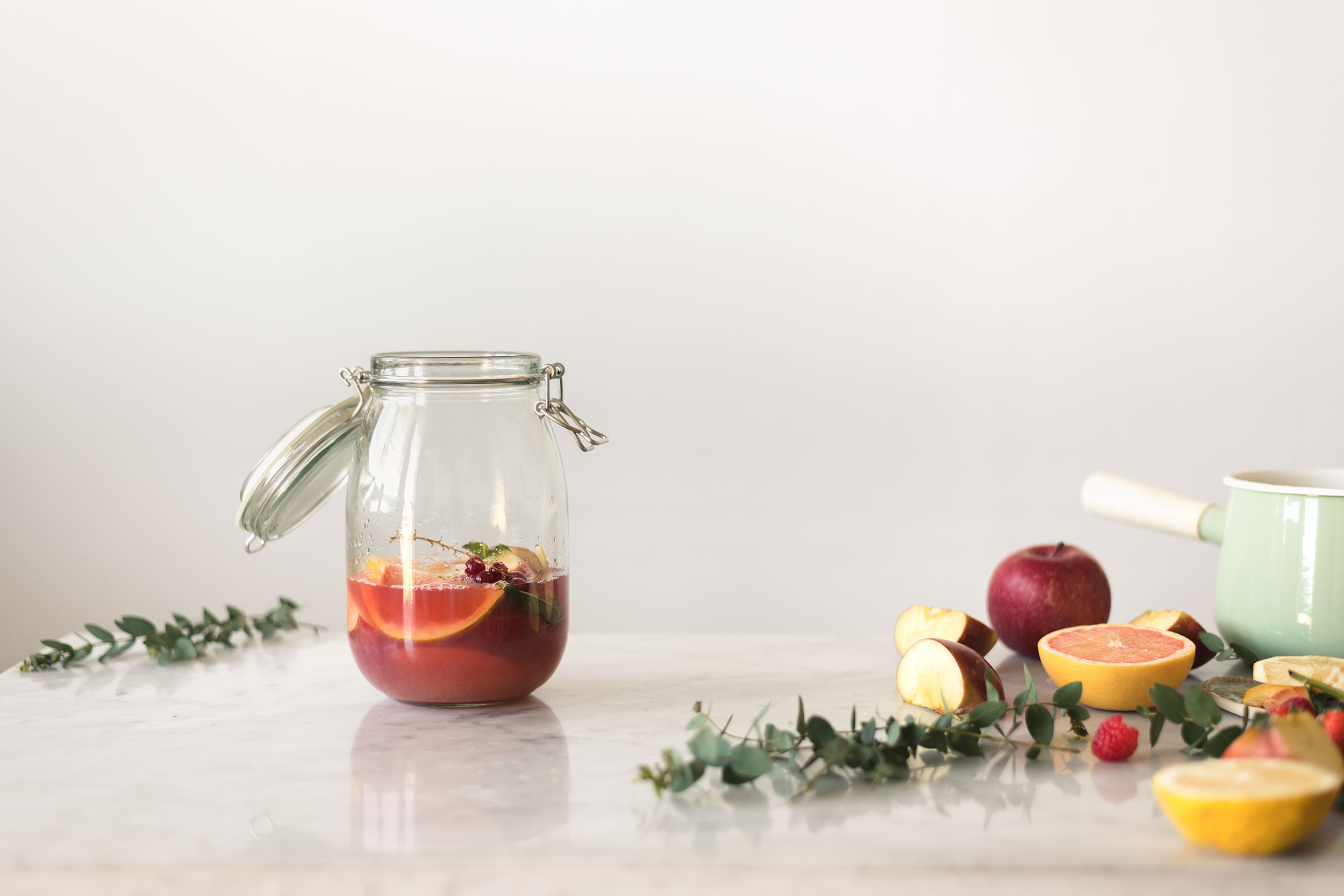 fruity iced tea with apples grapefruit raspberries and red currant